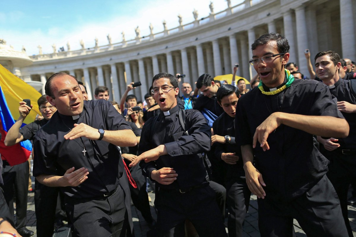 Image: Priests sing and dance in Saint Peter's Square at the Vatican