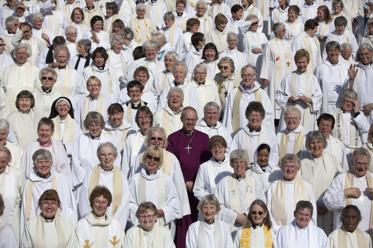 Image: The Archbishop of Canterbury Justin Welby poses with female priests after their march celebrating the twentieth anniversary of women becoming ordained priests in the Church of England in London