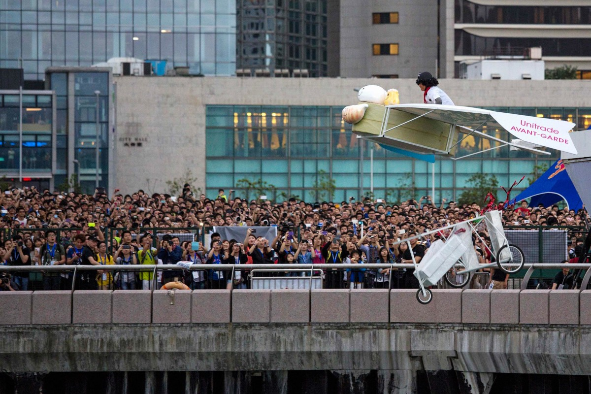 """Image: A participant operates the """"Flying Dim Sum,"""" a self-made flying machine"""