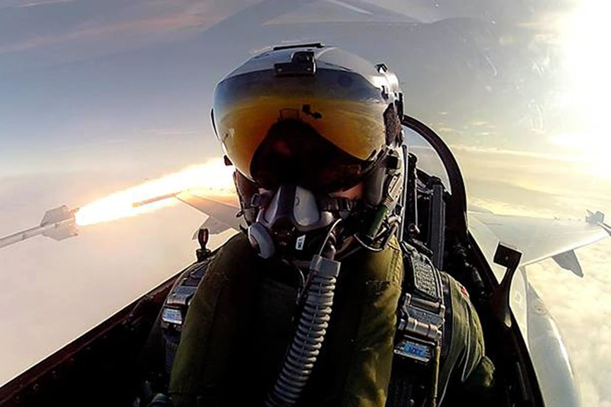 Royal Danish Air Force pilot Thomas Kristensen fires an AIM-9L air-to-air missile from his F-16 Fighting Falcon.