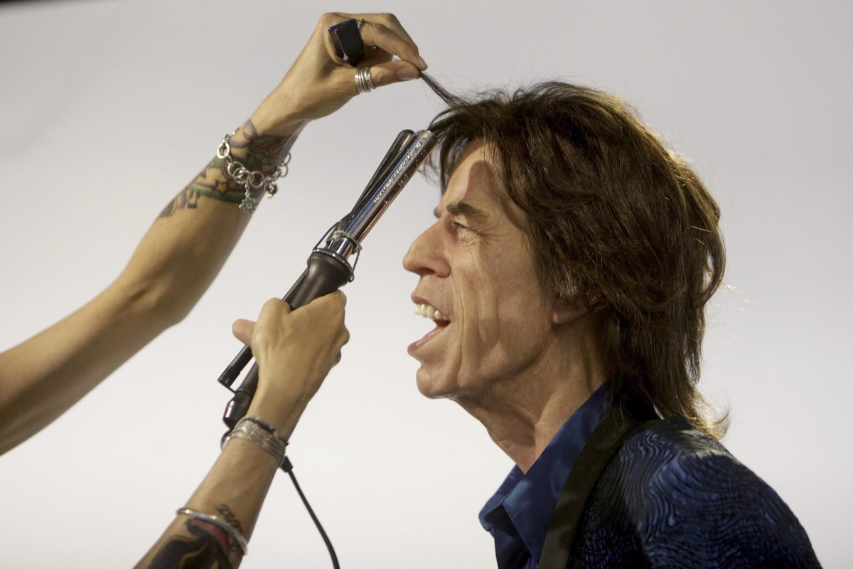 Image: Grevin Wax Museum hairdresser Virginie Dahan puts the final touches to Rolling Stones lead singer Mick Jagger wax statue in the Grevin Wax Museum in Prague