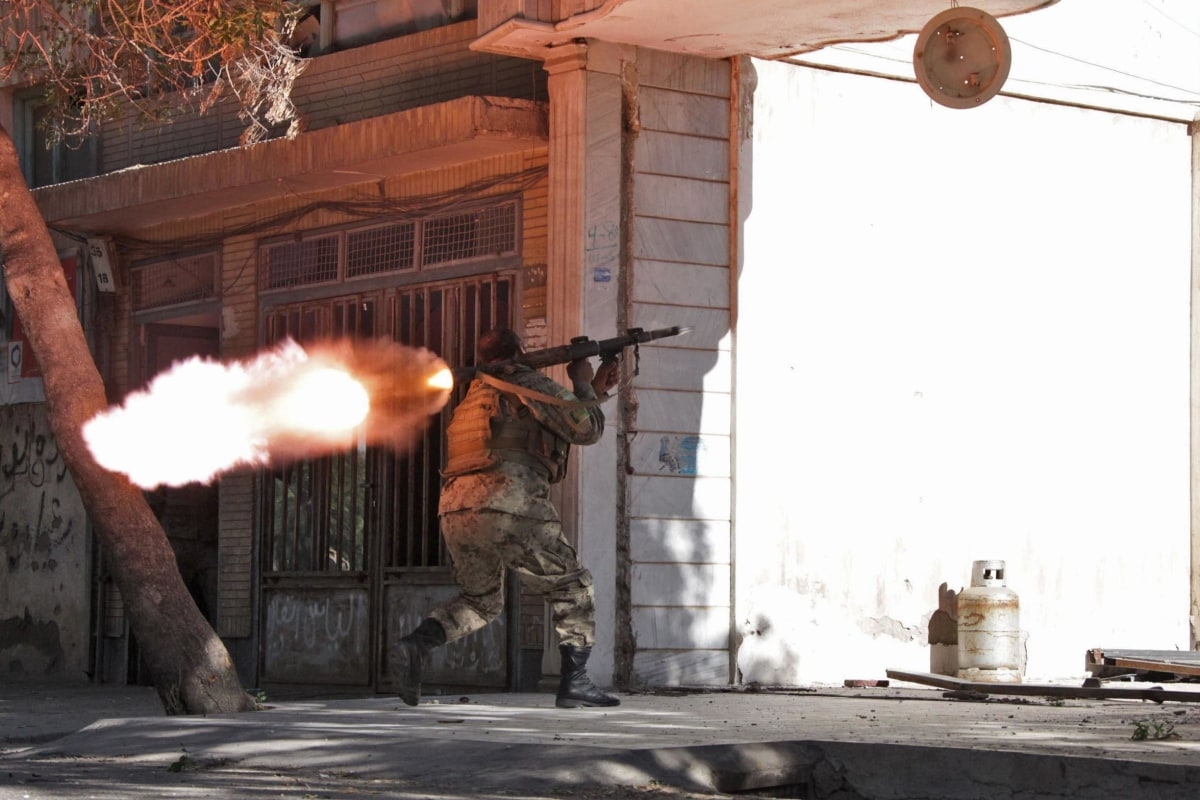 Image: An Afghanistan National Army (ANA) soldier fires his weapon