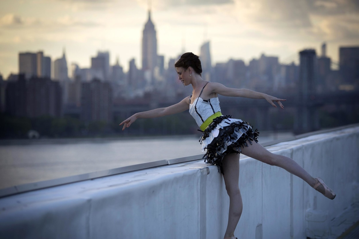 "Image: A model takes part in the ""Trashion"" fashion show on the roof of a building in the Brooklyn Navy Yard"