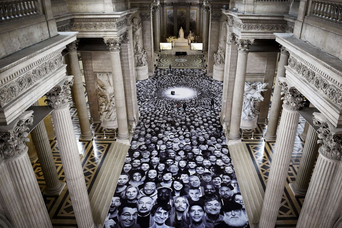 Image: Photos from a project by French photographer JR are displayed on the ground of the Pantheon in Paris