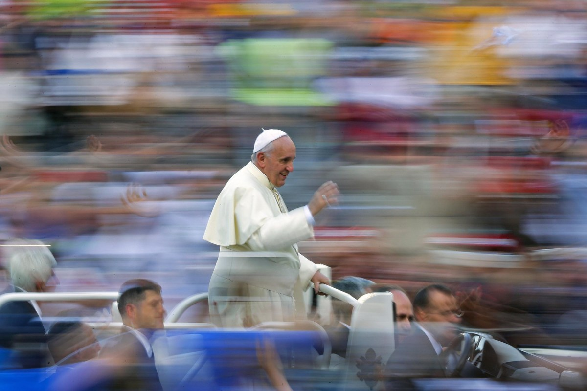 Image: Pope Francis waves as he leads a special audience in Saint Peter's Square at the Vatican