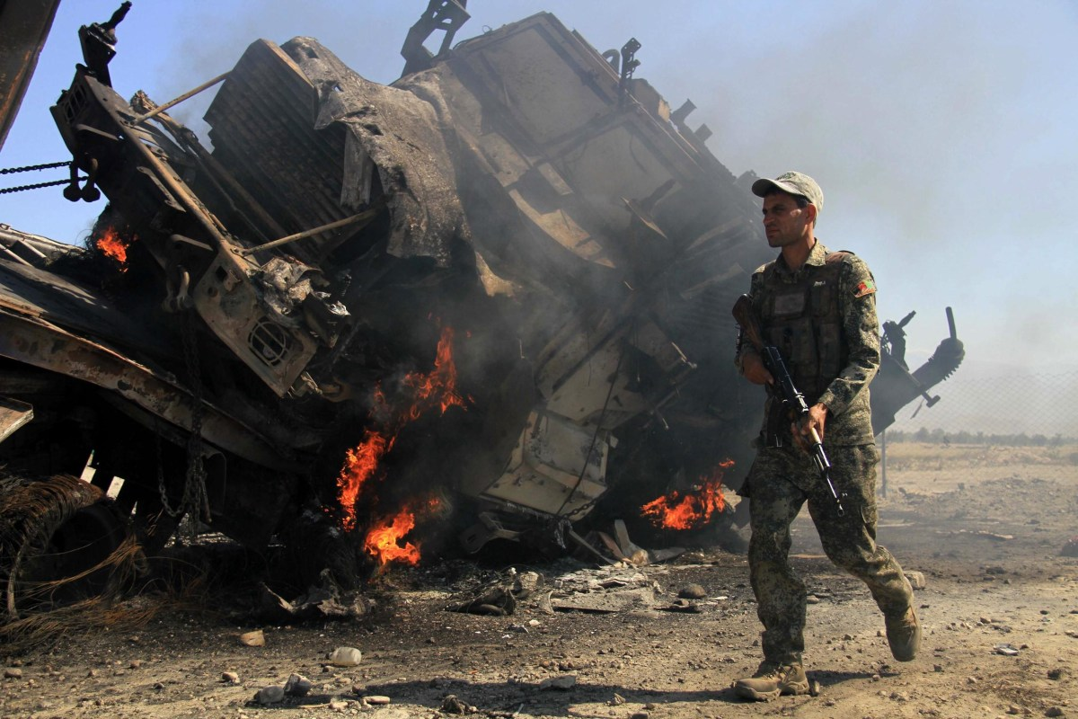 Image: Suicide bombers attack police compound in eastern Afghanistan