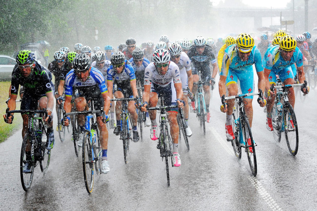 Image: The pack of riders competes in heavy rain during the 8th stage of the 101st Tour de France cycling race, over 161 km from Tomblaine to Gerardmer La Mauselaine, in France