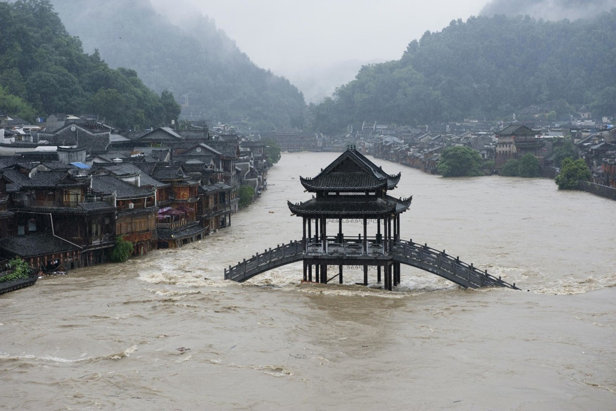Image: A bridge submerged in floodwaters in the ancient town of Fenghuang