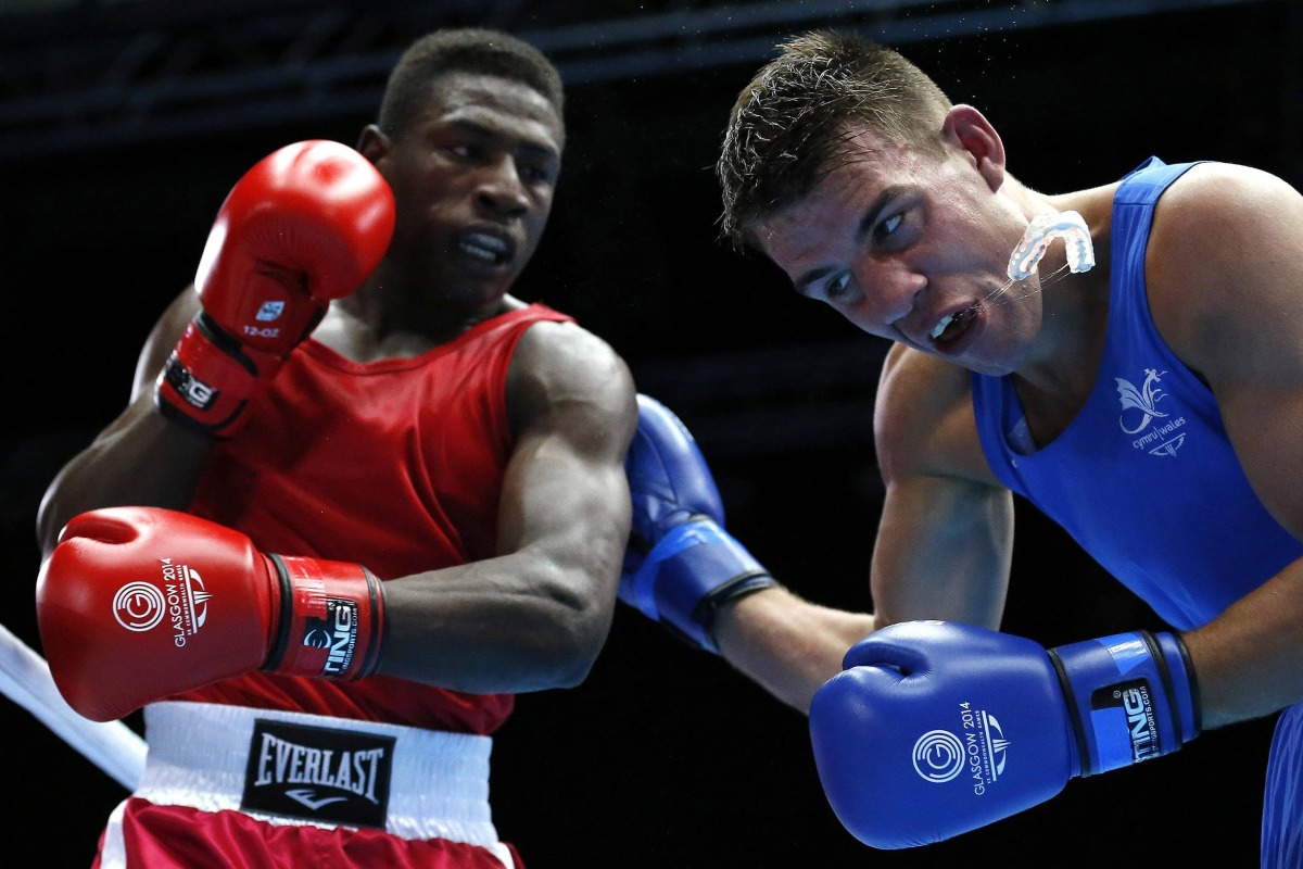 Image: Wales' Thorley loses his mouth guard from a punch from Mauritius' St. Pierre during their men's Light Heavy Weight boxing match at the 2014 Commonwealth Games in Glasgow