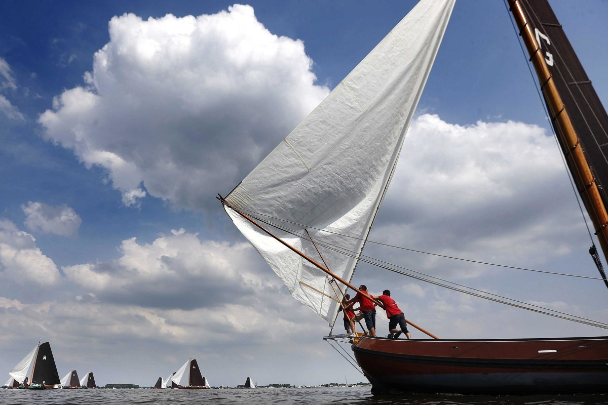 Image: Traditional Frisian sailing boats, known as skutsjes, compete on the Snekermeer during the final day of the annual race on the Frisian lakes, The Netherlands