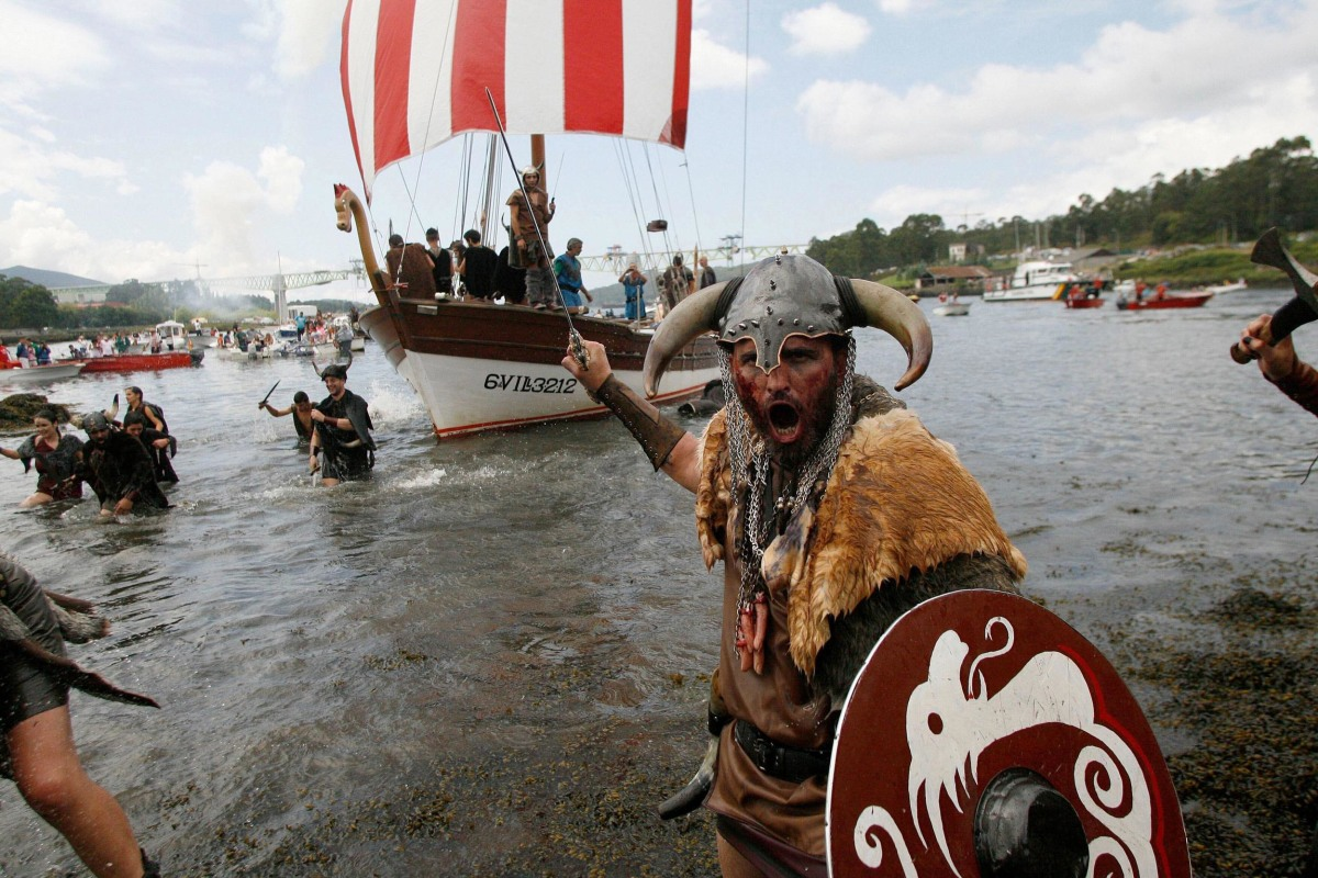 Image: Residents of Catoira town recreate a Viking invasion during a traditional festival in Catoira,