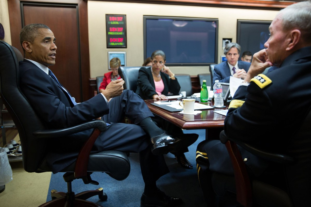 Image: President Barack Obama meets with the National Security Council in the Situation Room of the White House, Aug. 7