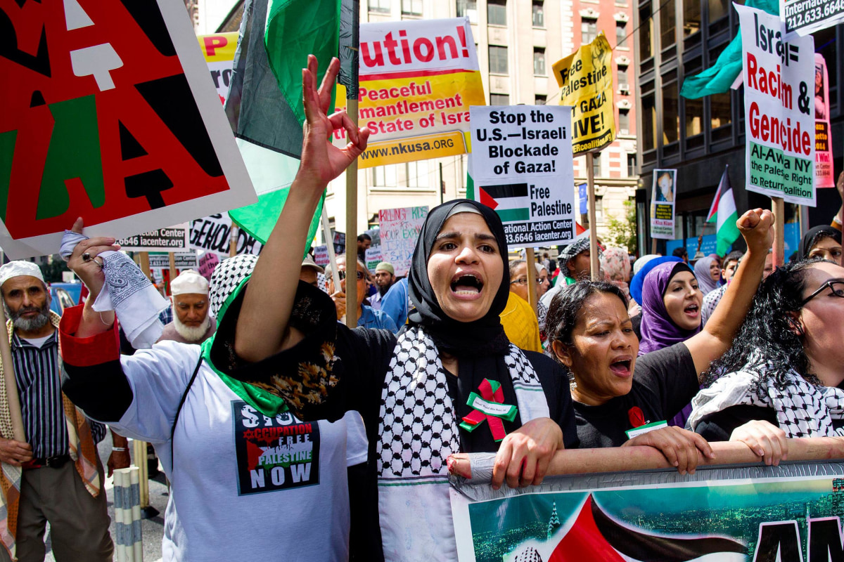 Image: Safa Khouli, center, of New York, marches in support of ending the violence in Gaza during a rally in New York, Saturday, Aug. 9.