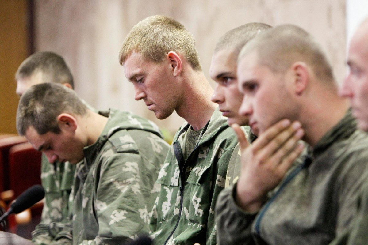 Image: A group of Russian servicemen, who are detained by Ukrainian authorities, attend a news conference in Kiev