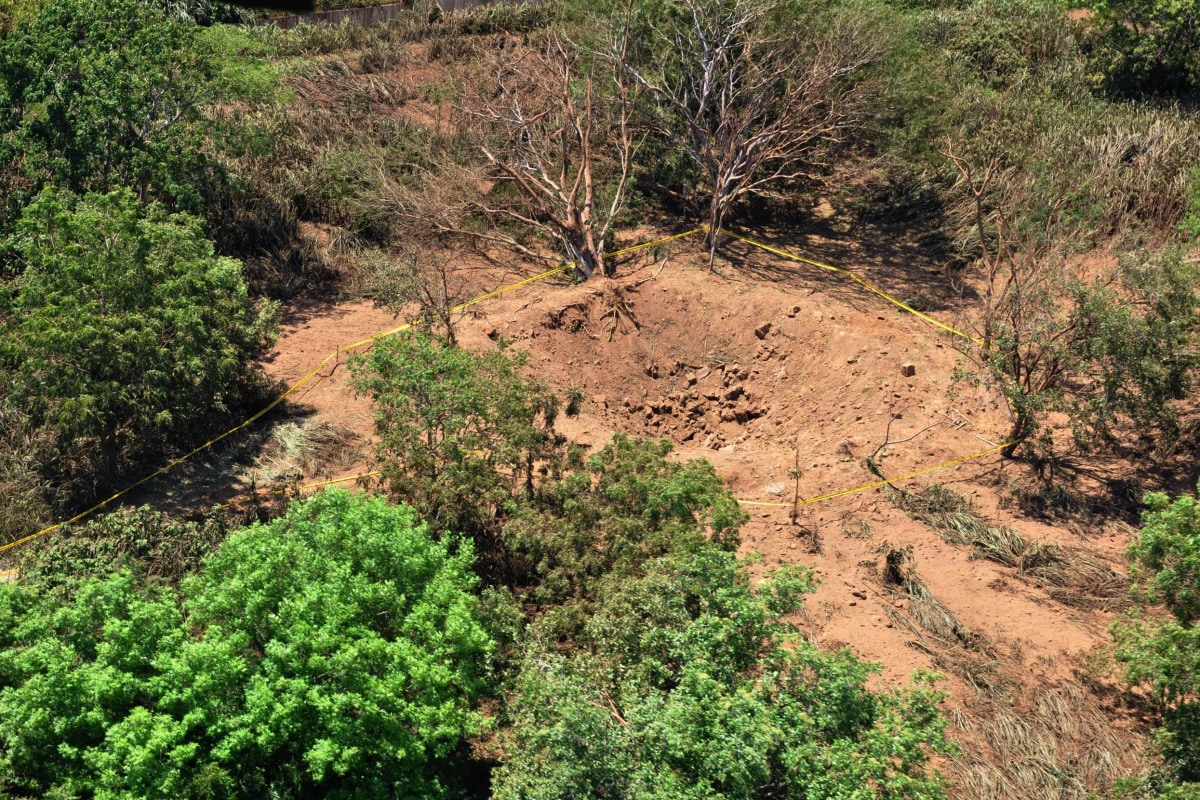 Image: An impact crater made by a small meteorite in a wooded area near Managua's international airport and an air force base.
