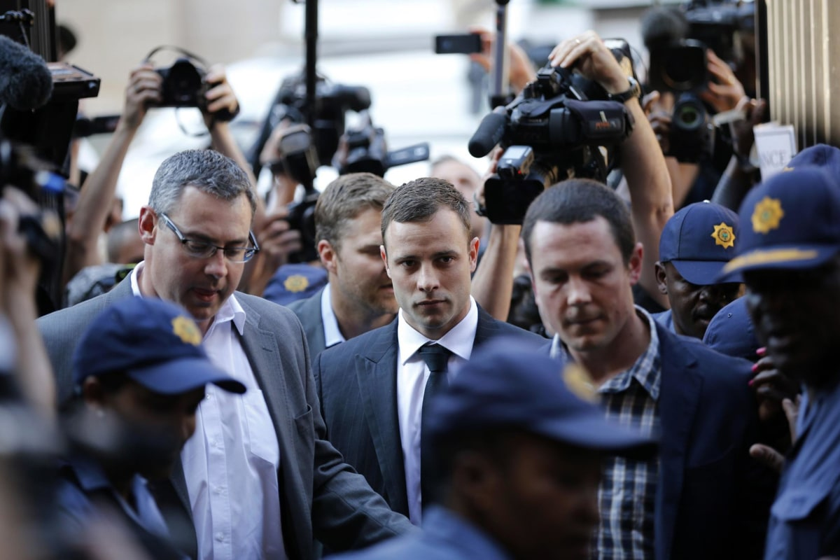 Image: Oscar Pistorius arrives for the verdict in his murder trial at the high court in Pretoria