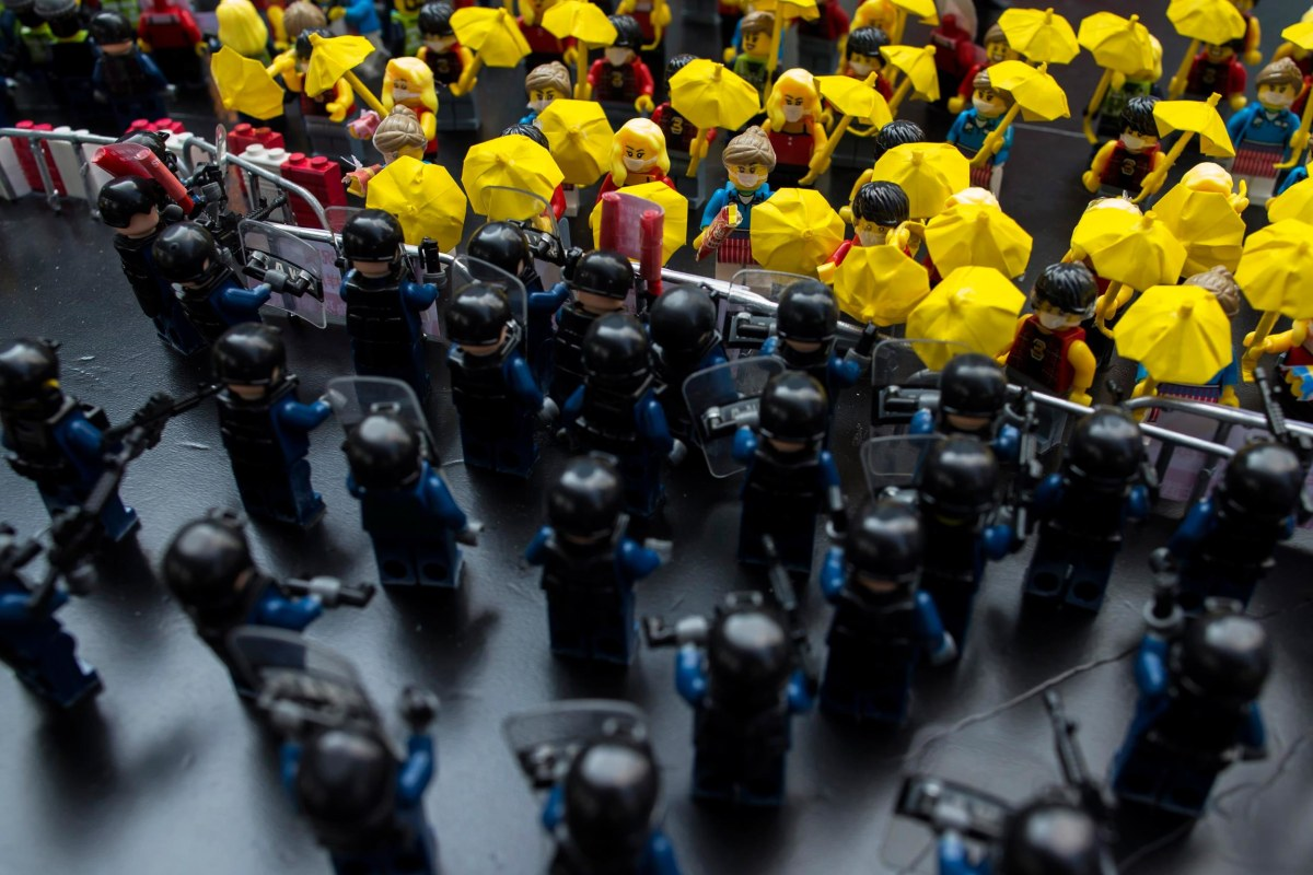 Image: Toy Lego characters depicting a scene of protesters confrontation riot police are seen on a table outside the government headquarters in Hong Kong