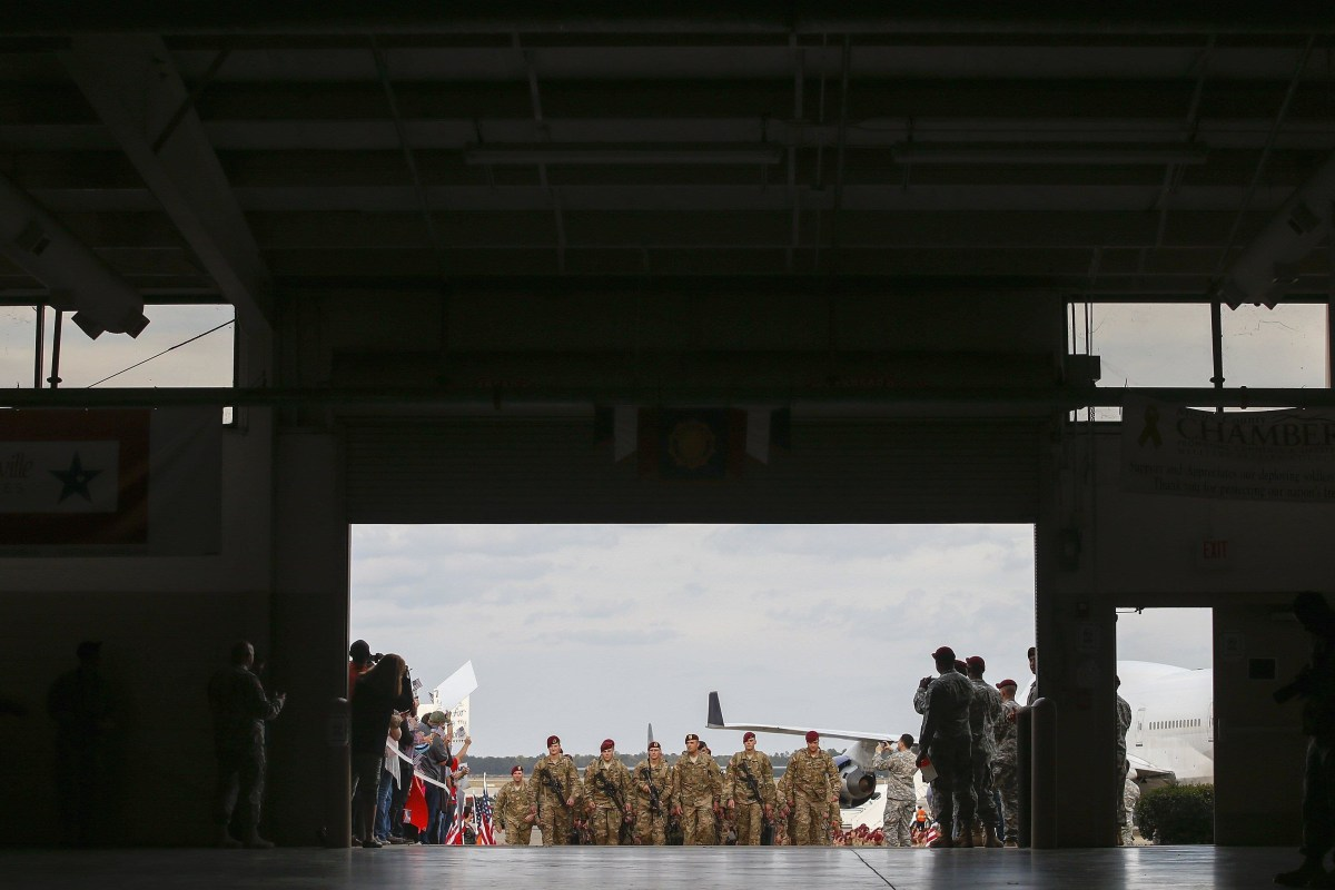 Image: Paratroopers with the 1st Brigade Combat Team, 82nd Airborne Division march up the ramp as they return home from Afghanistan, at Pope Army Airfield in Fort Bragg