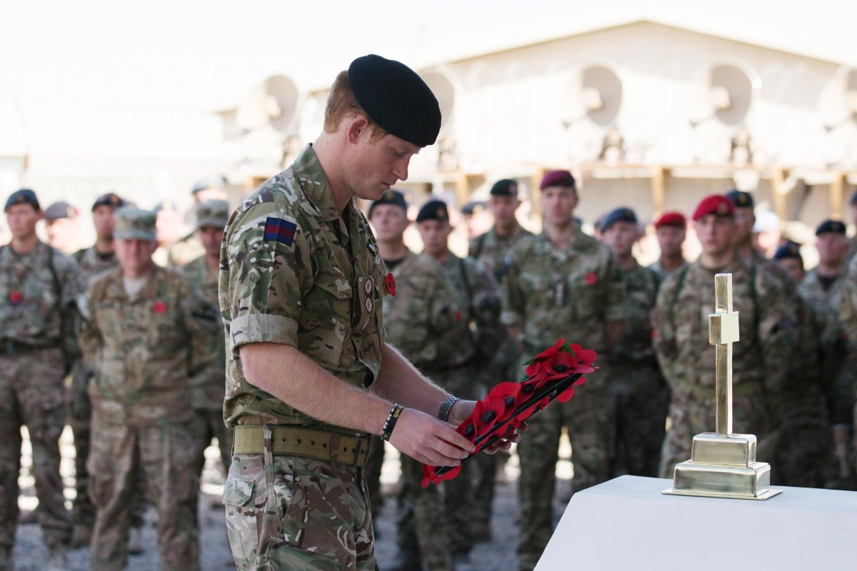 Image: Prince Harry lays a poppy wreath as he joins British troops and service personal remaining in Afghanistan