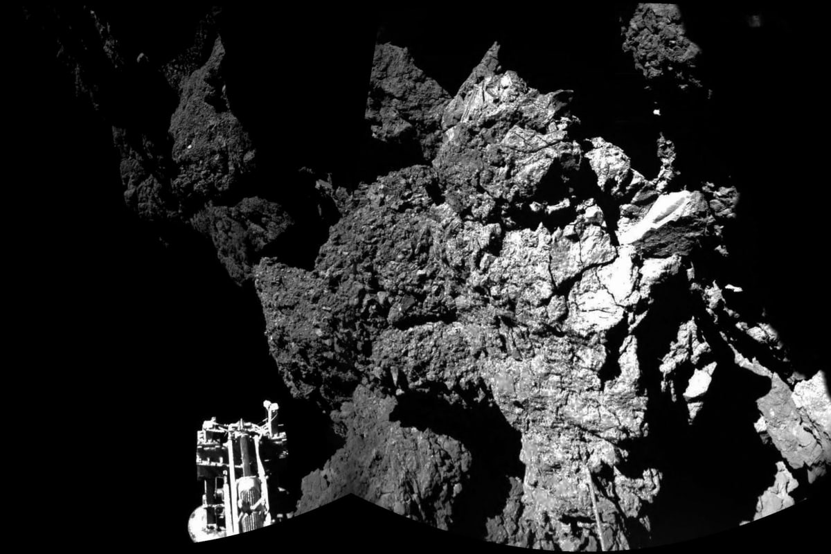 Rosetta's lander Philae is safely on the surface of Comet 67P/Churyumov-Gerasimenko, as these first two CIVA images confirm. One of the lander's three feet can be seen in the foreground.