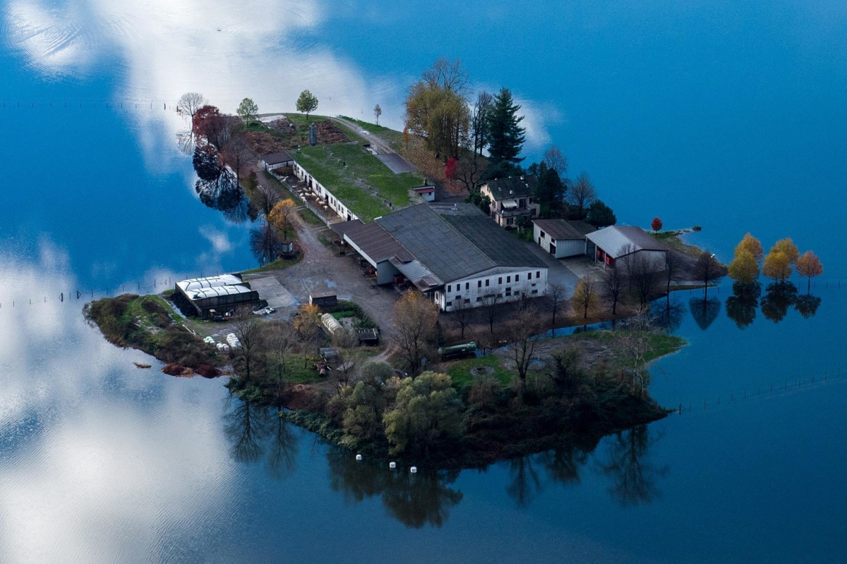 Image: Floodwaters surround a farm  near the village of Magadino in Ticino, Switzerland