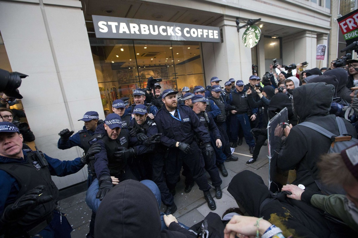 Image: Protesters clash with police outside London Starbucks