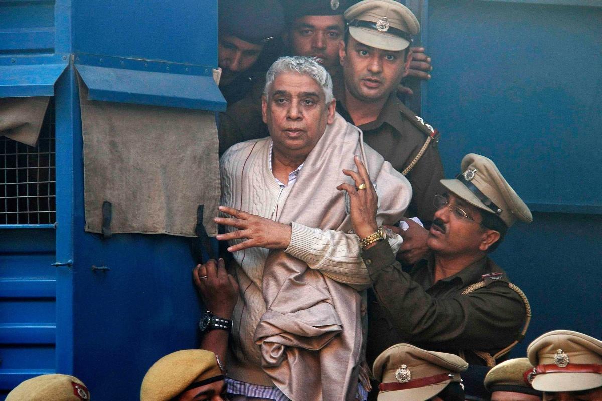 "Image: Satguru Rampalji Maharaj, a self-styled ""godman"" is escorted to the high court after his arrest, in Chandigarh"