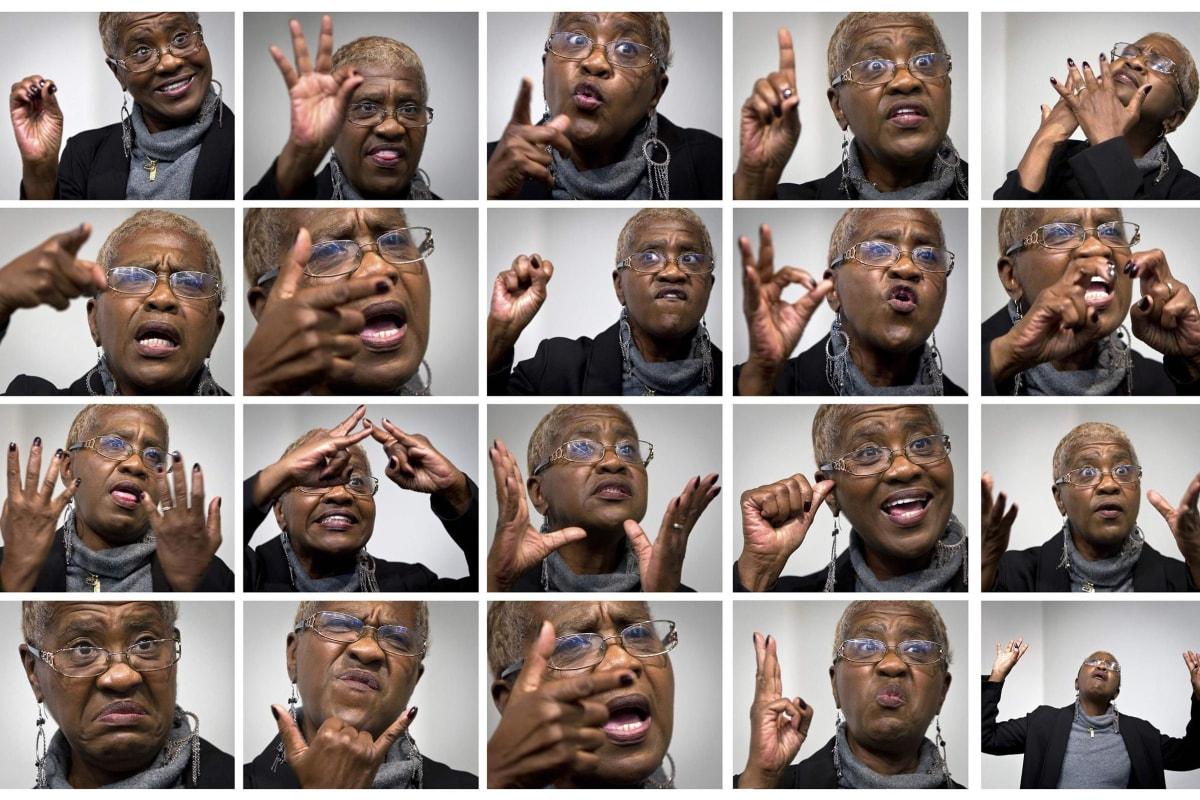 Image: Combination photo shows sign language interpreter Christine Dudley
