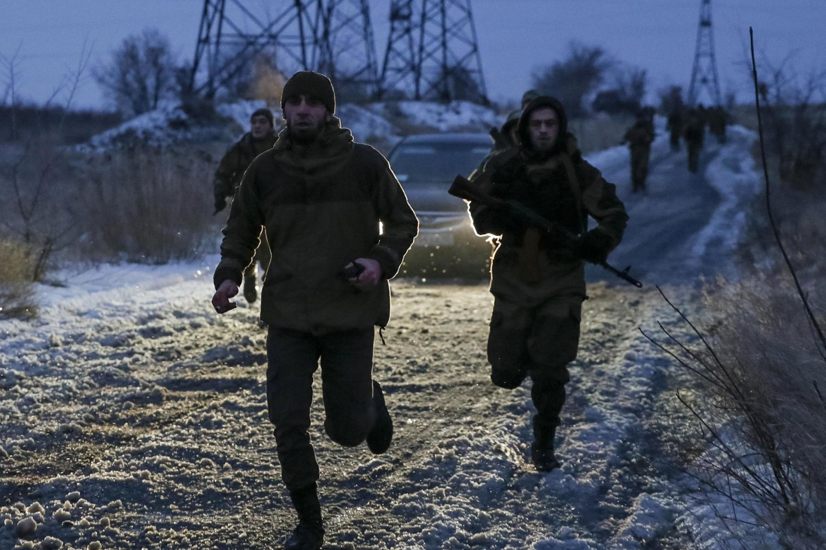 "Image: Pro-Russian separatists from the Chechen ""Death"" battalion run during a training exercise in the territory controlled by the self-proclaimed Donetsk People's Republic"