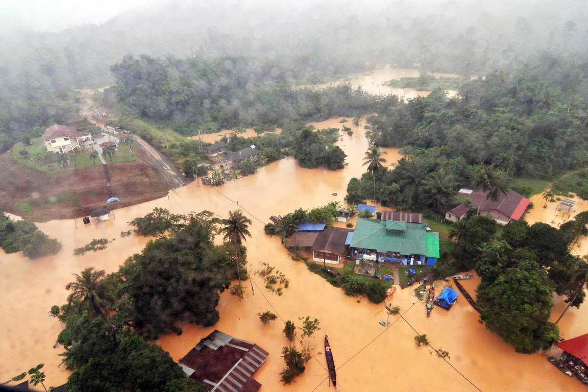 Image: An aerial view of flooded streets of the National Park in Kuala Tahan, Pahang