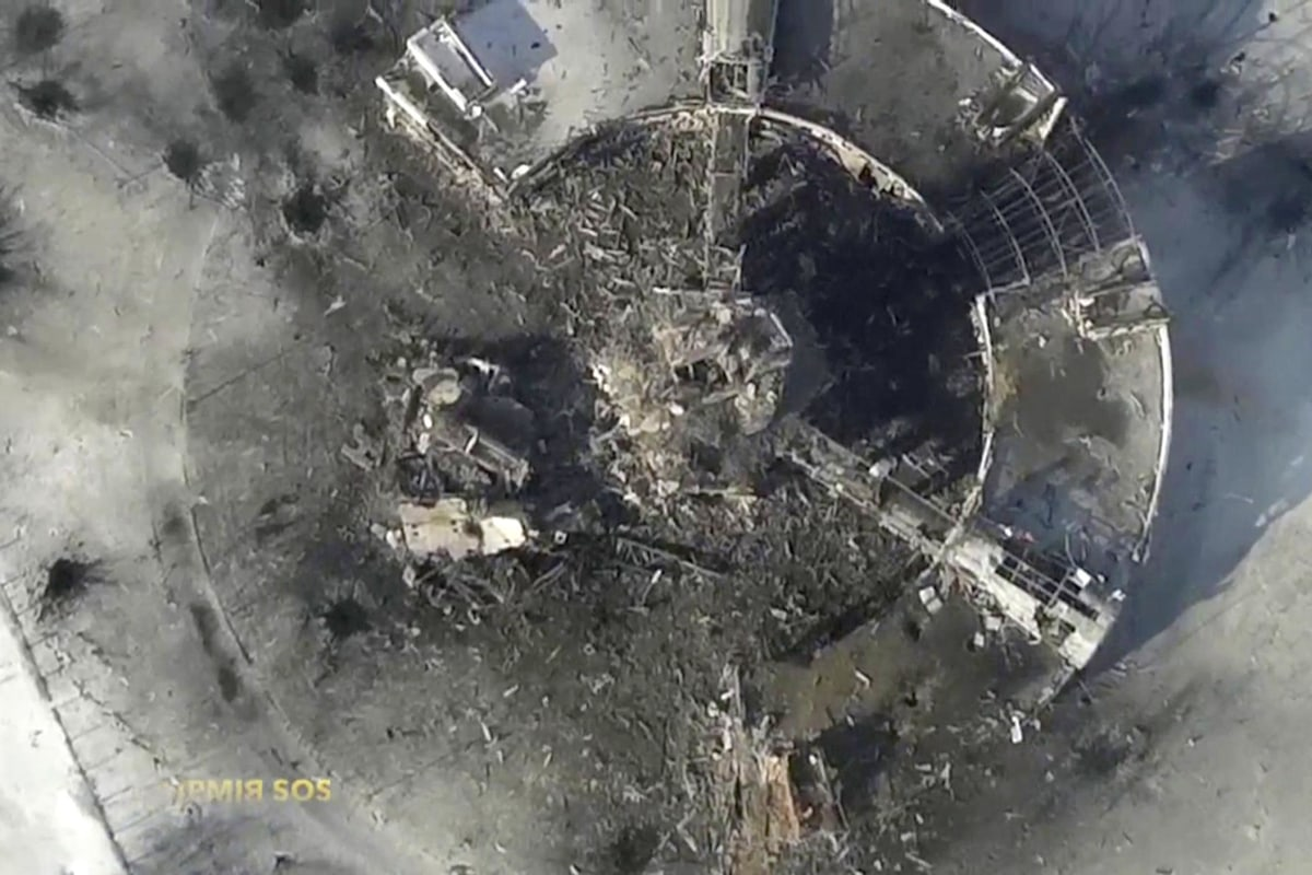 Image: Still image taken from handout aerial footage shot by a drone shows a multi-storey control tower of the Sergey Prokofiev International Airport damaged by shelling during fighting between pro-Russian separatists and Ukrainian government forces, in D