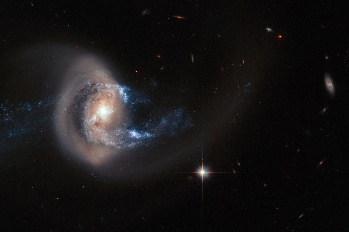 Hubble's Latest Hit: Galaxy Gets Caught in Gravitational ...