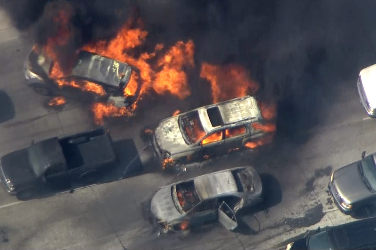 cars set ablaze as fire jumps freeway in california - television