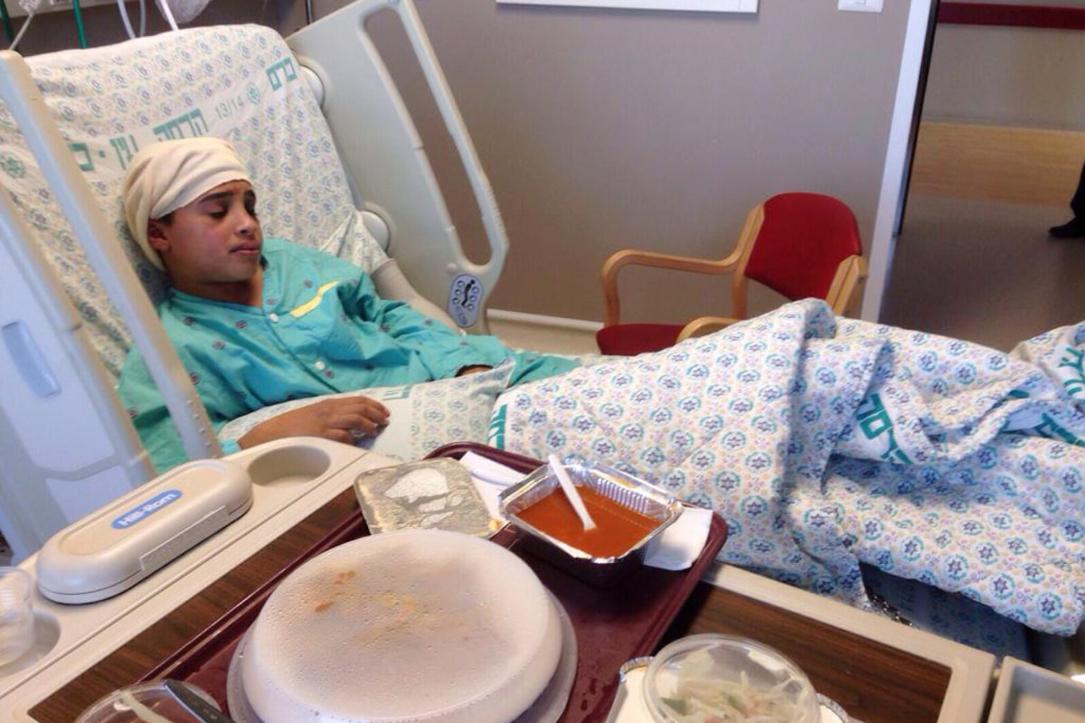 Image: Israeli police released this image of Ahmed Manasrah, 13, at a hospital in Jerusalem