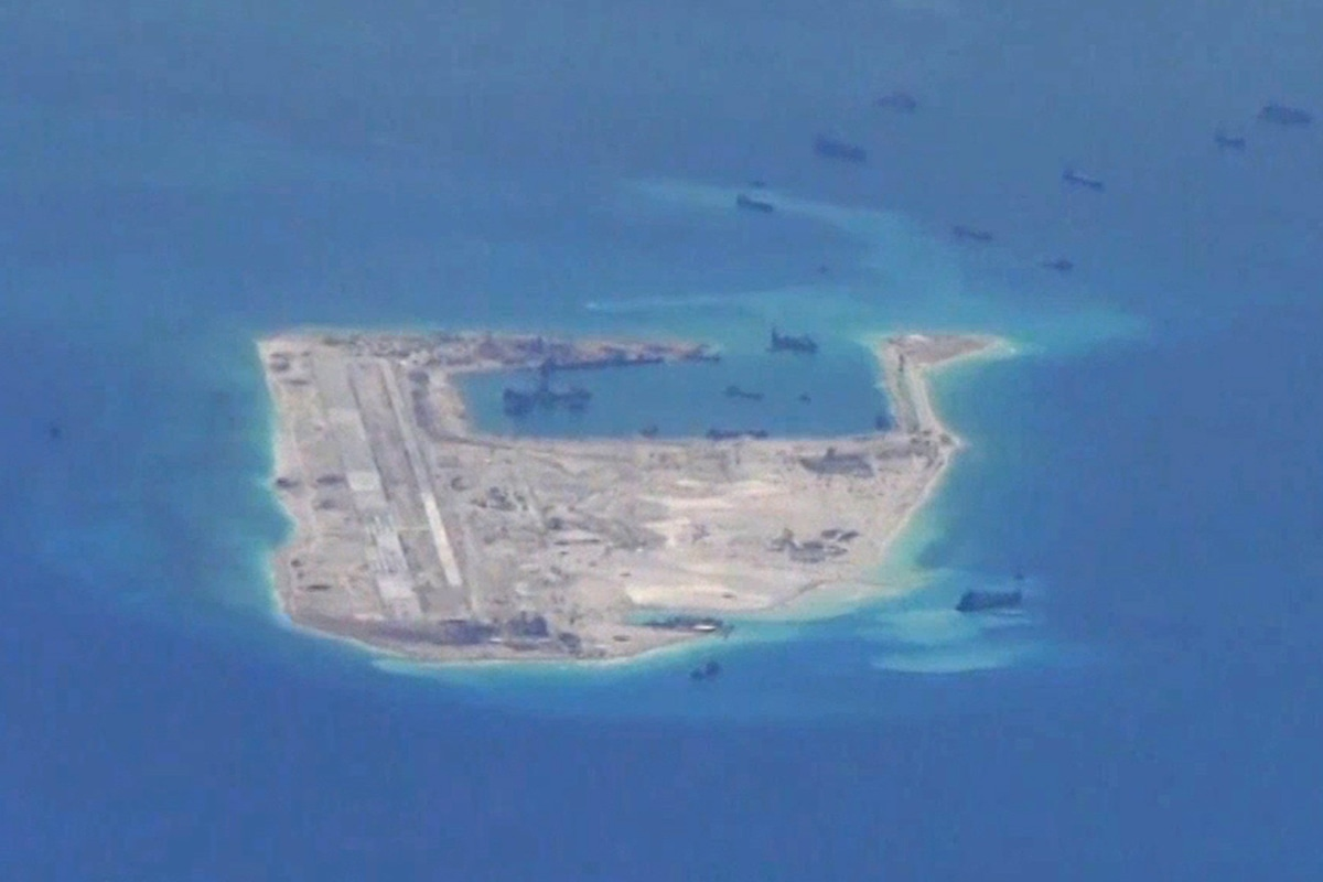 China Lands Plane on Artificial Island in Disputed South China Sea ...