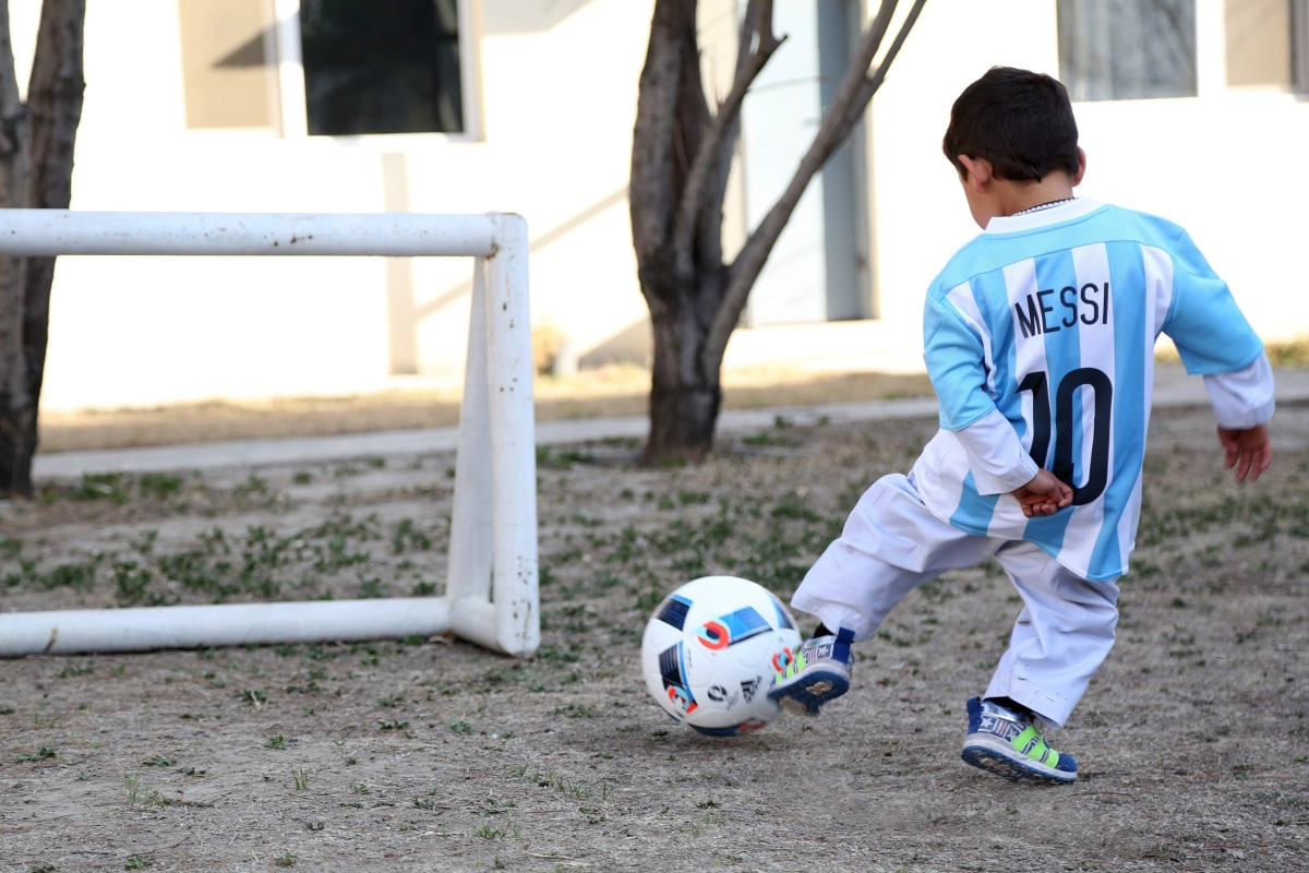 Image: Messi Jersey Afghan Boy Playing