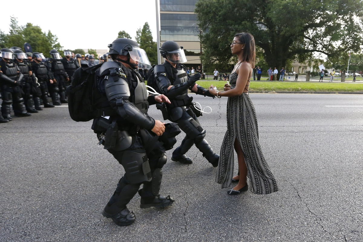 Image: A demonstrator protesting the shooting death of Alton Sterling is detained by law enforcement near the headquarters of the Baton Rouge Police Department in Baton Rouge, Louisiana