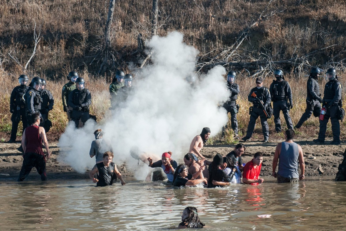 Police fire rubber bullets as pipeline protesters try to protect burial site