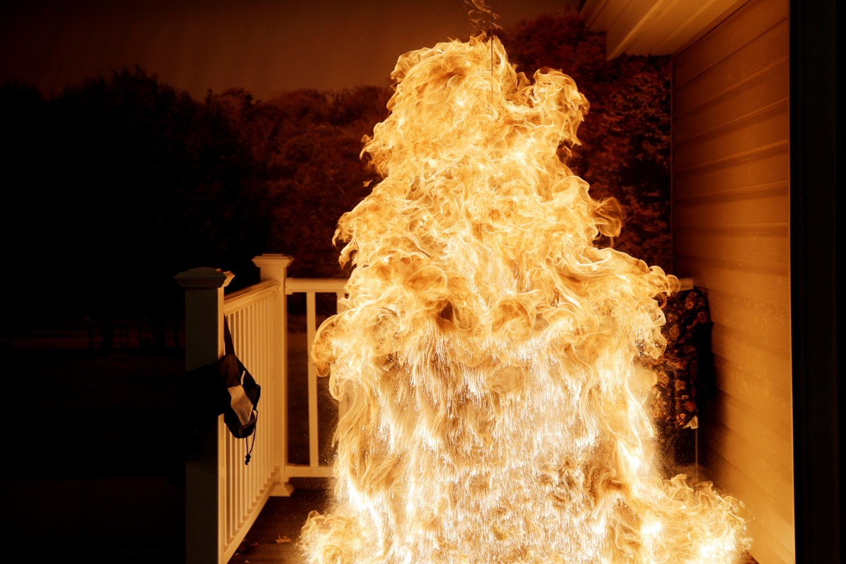 Image: Frozen turkey is dropped into deep fryer and creates a large fireball