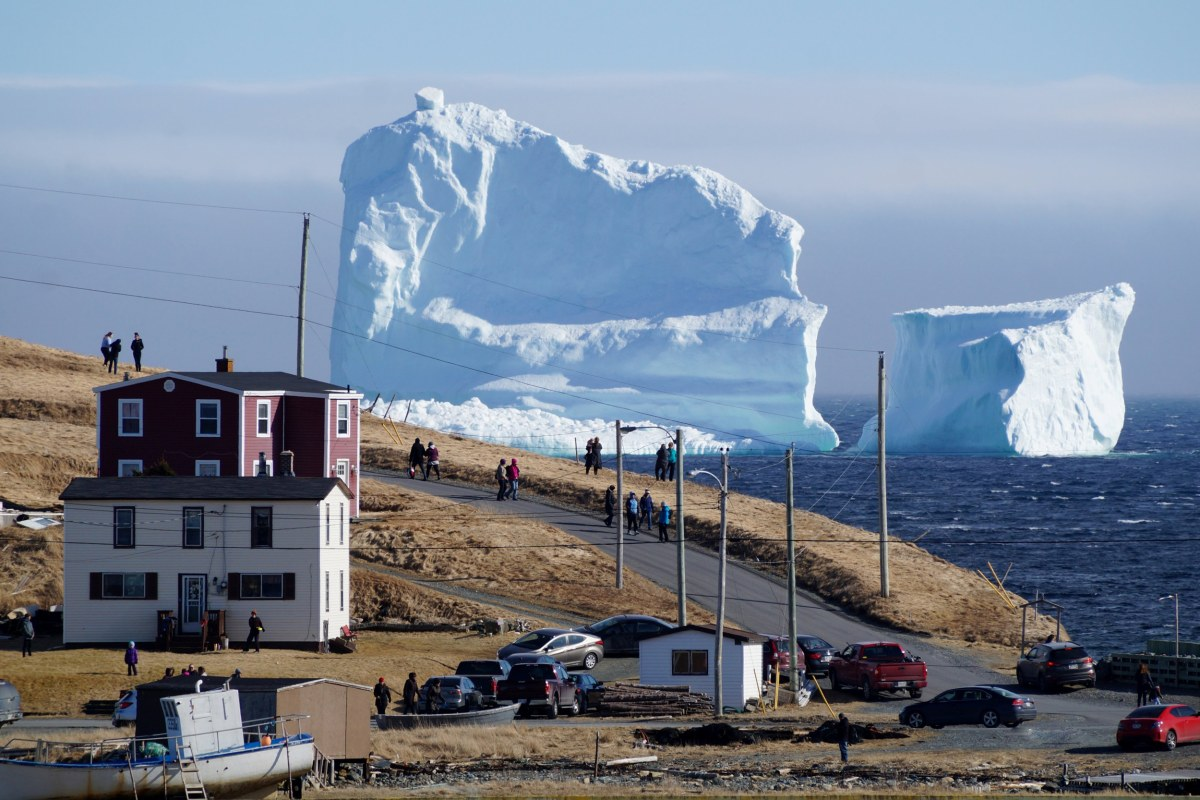 Image: Residents view the first iceberg of the season as it passes the South Shore of Newfoundland