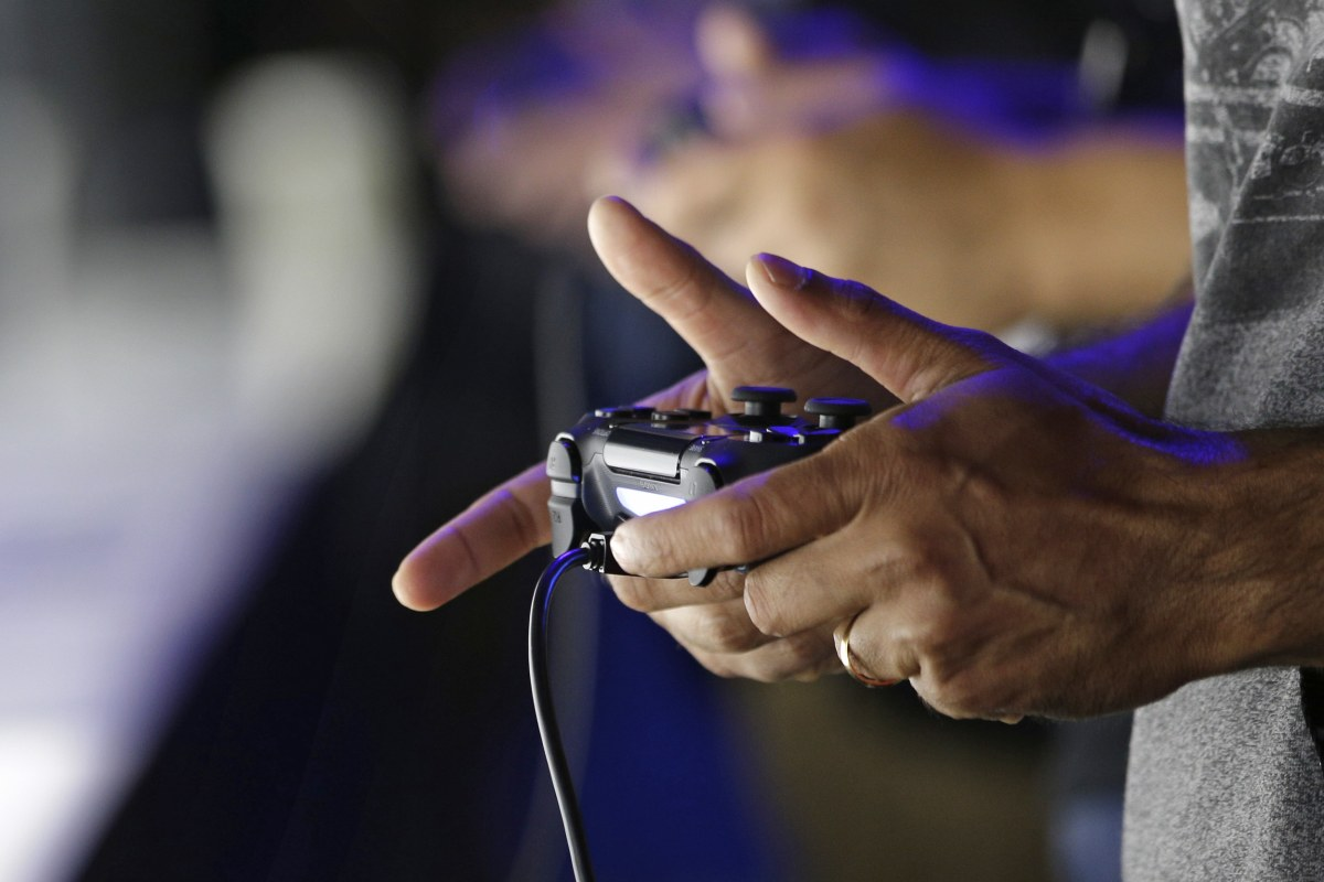 Close-up of hands holding PS4 Controller
