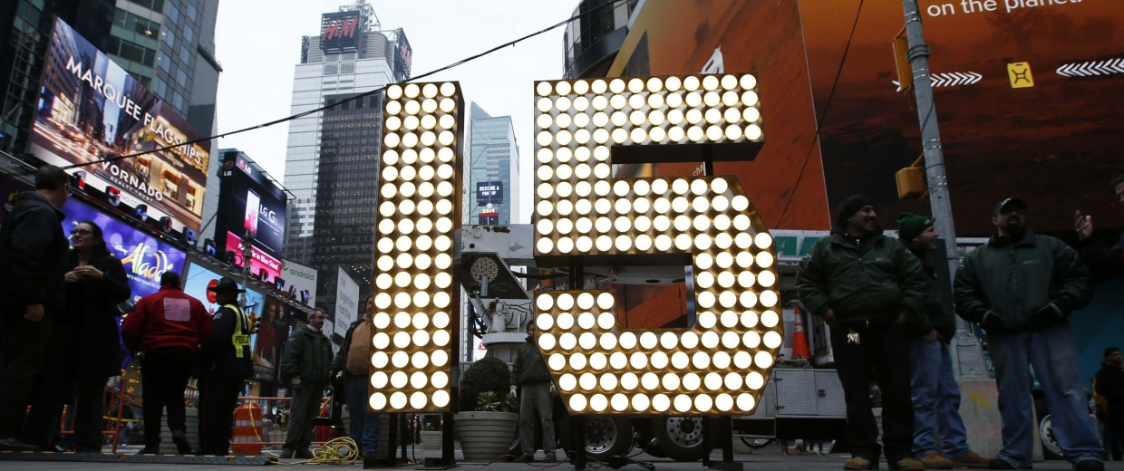 "Image: New Year's Eve ""15"" numerals stand lit on the sidewalk after they were unloaded from a truck in Times Square in New York"