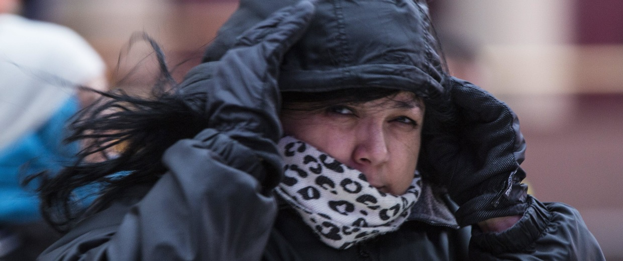 Image: A commuter is bundled against the cold weather after emerging from Pennsylvania Station in New York City on Thursday.