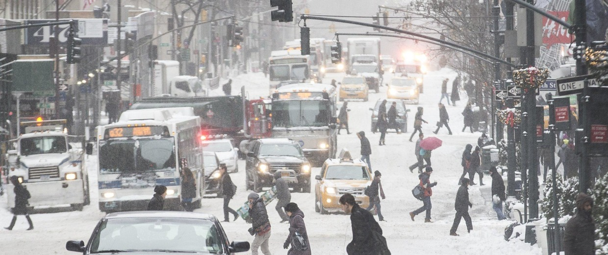 Image: Pedestrians brave wind and snow as they cross Fifth Avenue, Friday, Jan. 3, 2014, in New York.