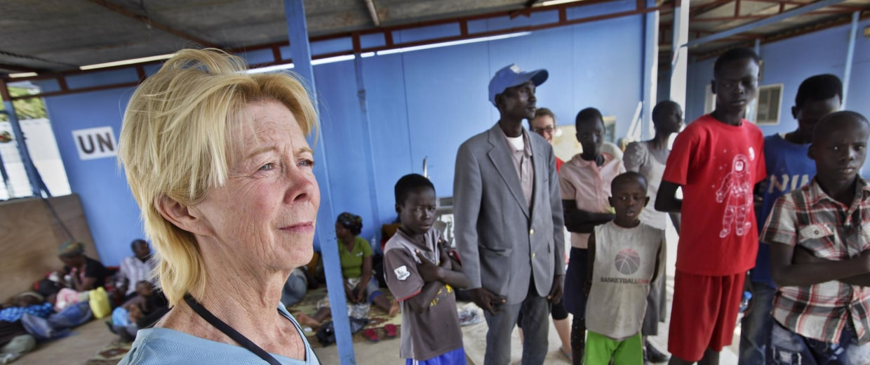 Image: American Kim Campbell from Nebraska stands with some of the 10 orphan children she and her husband Brad are raising
