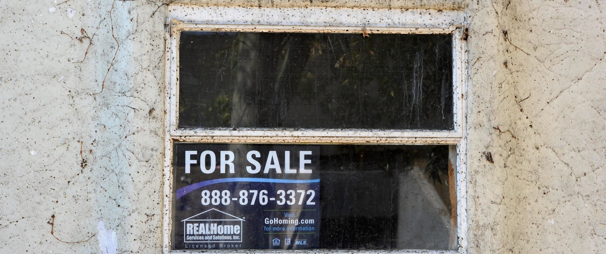 A for-sale sign in a house in Glendale, California. The rise in house prices is sparking an increase in home seizures as lenders figure they can sell the property now.