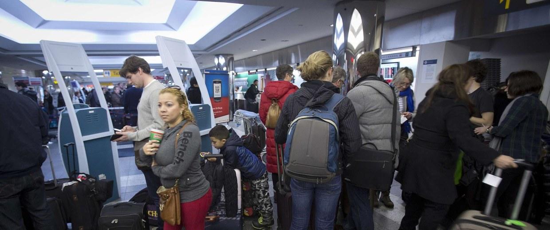 Image: Travelers at La Guardia airport in New York