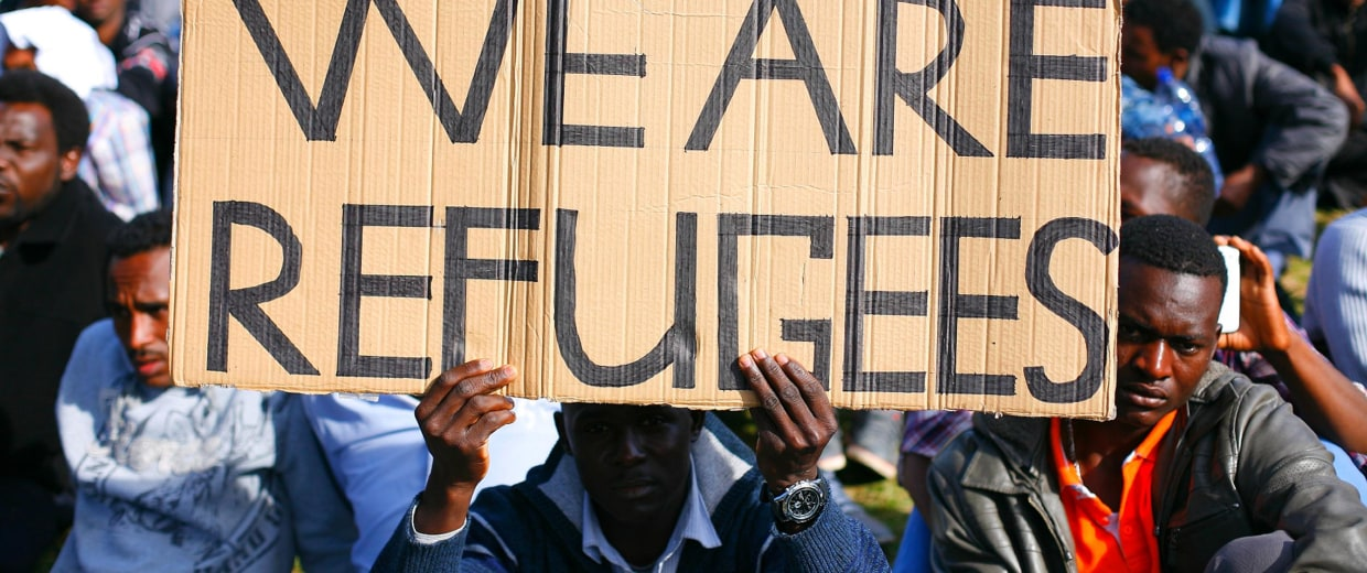 A man holds a sign during a demonstration in south Tel Aviv against Israeli government policies towards African migrants.