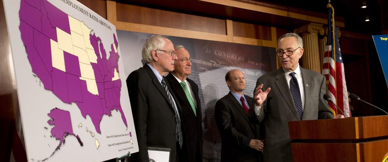 Image: Charles Schumer, Tom Harkin, Bernie Sanders, Chris Coons