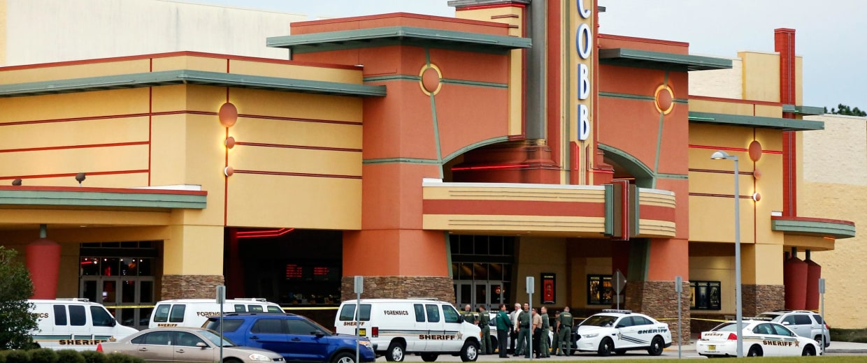 Image: Police tape surrounds the Cobb Grove 16 movie theater in Wesley Chapel